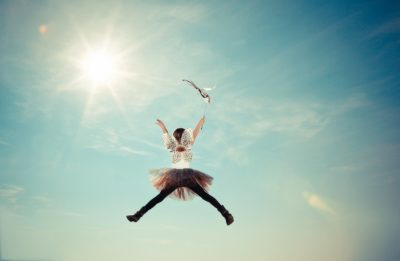 A little girl jumping through the air